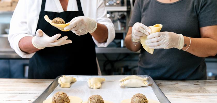 FOUND/LA Entrepreneur, Lia Hirtz, Founder of World Empanadas and her sister making empanadas by hand